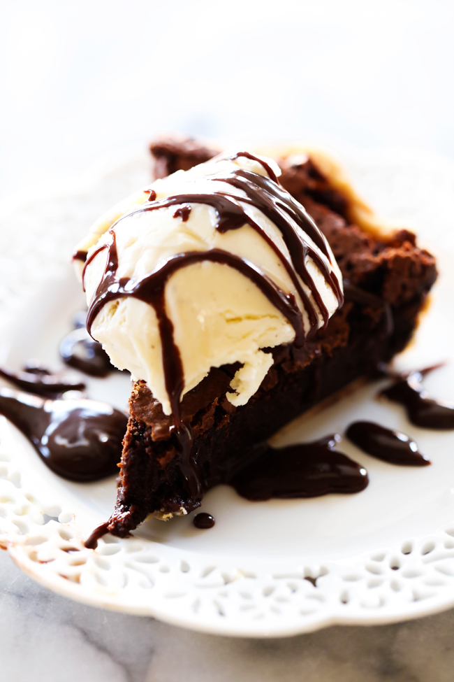 This Brownie Pie is fudgy, rich and divine! It is absolute perfection topped with ice cream and hot fudge. This is a delicious addition to any dessert table and will be one of the first pies to disappear.