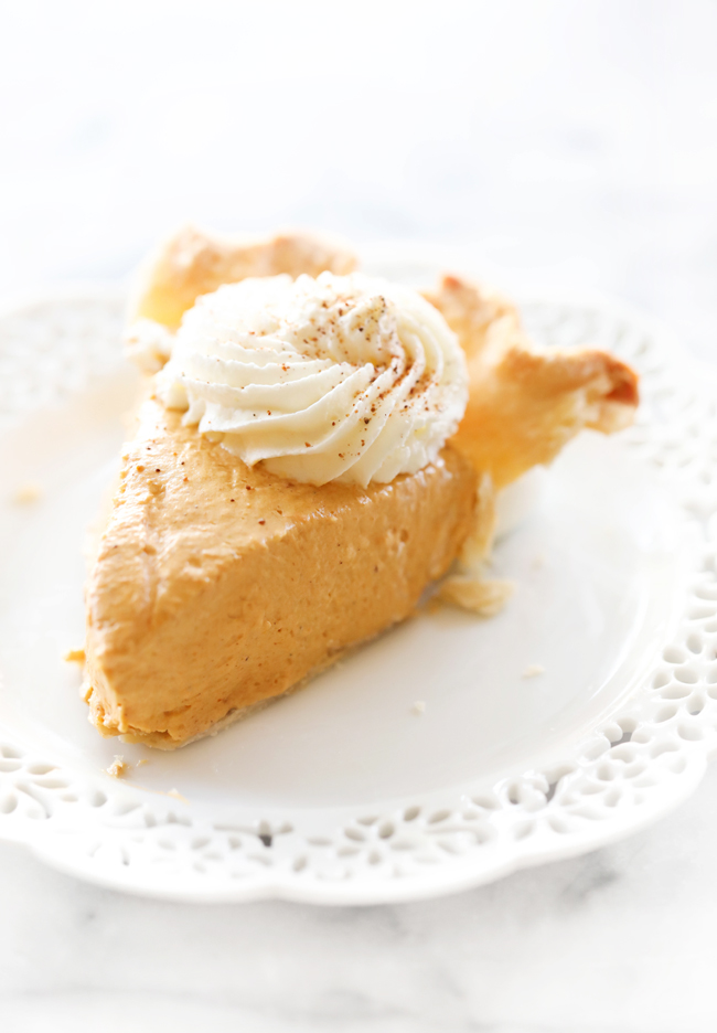 Slice of Marshmallow Pumpkin Pie on white plate.