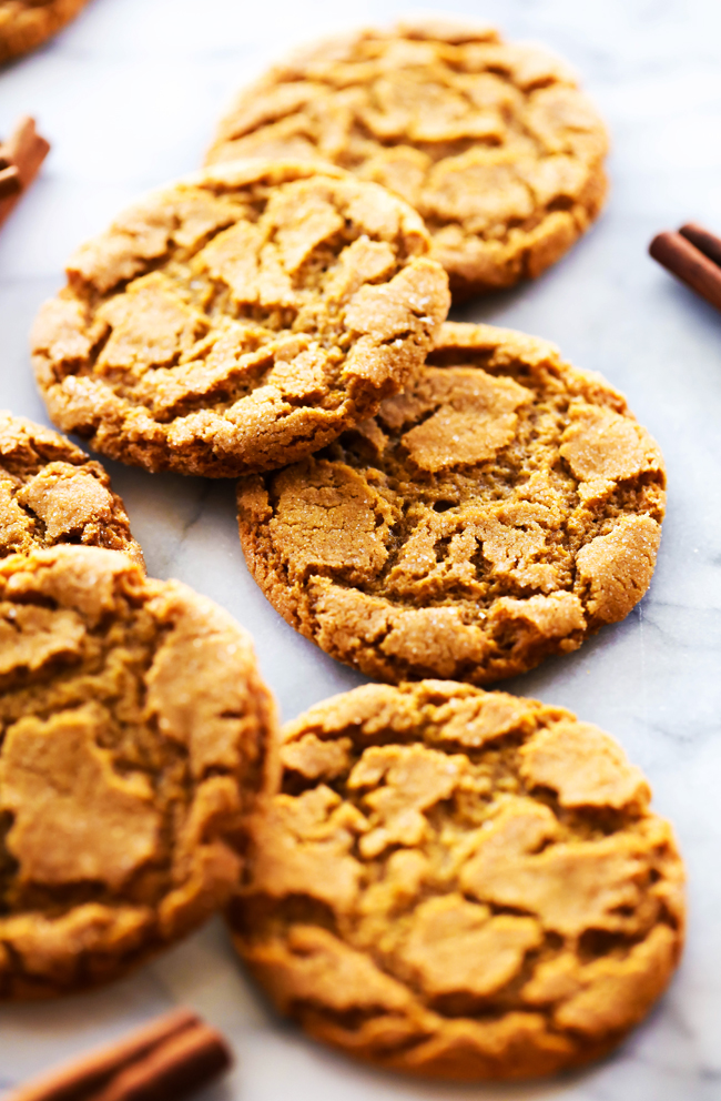 Crisp Gingersnaps scattered on a marble slab.