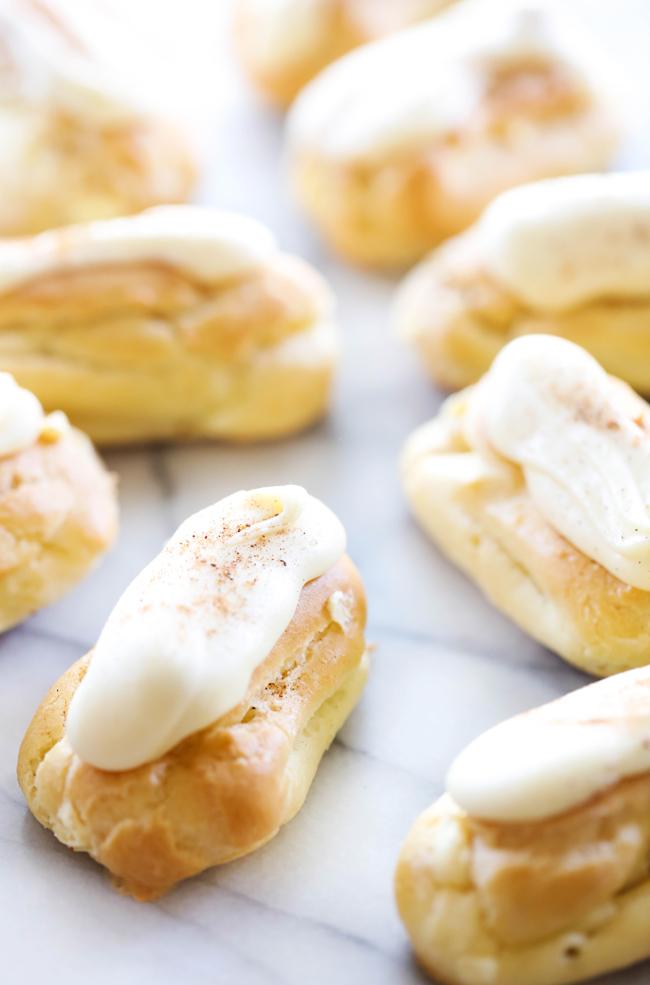 These Eggnog Eclairs have a light and fluffy pastry shell that is filled with a delicious eggnog cream and topped with an eggnog frosting. They are a delightful and delicious holiday treat!