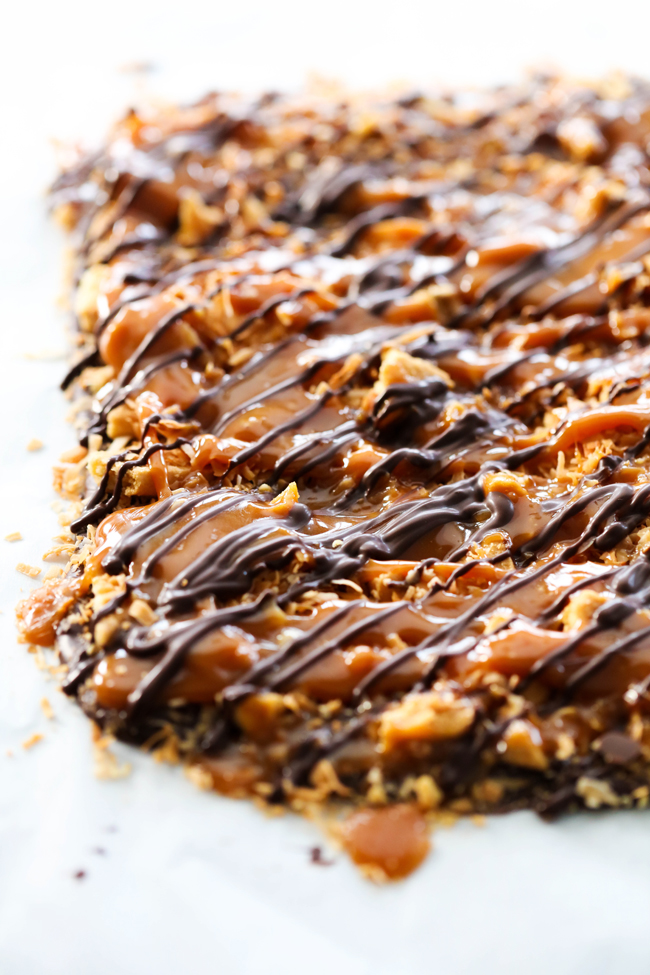 This Samoa Bark has everything you love about the favorite cookie: shortbread cookies, chocolate, caramel and coconut. It is all combined to make a delicious bark that will be gone in seconds! The texture, flavor, and ease make it highly addictive and perfect year round!