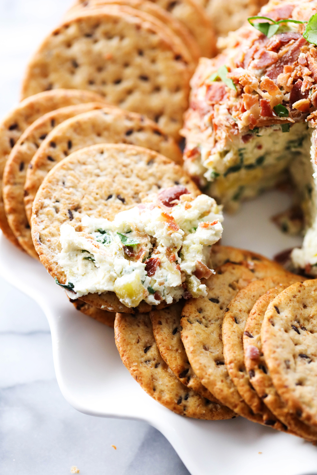 This Spinach Artichoke Cheese Ball is spectacular! It transforms a favorite dip into a new delicious creation that is so easy to make. It is perfect for gatherings and events.