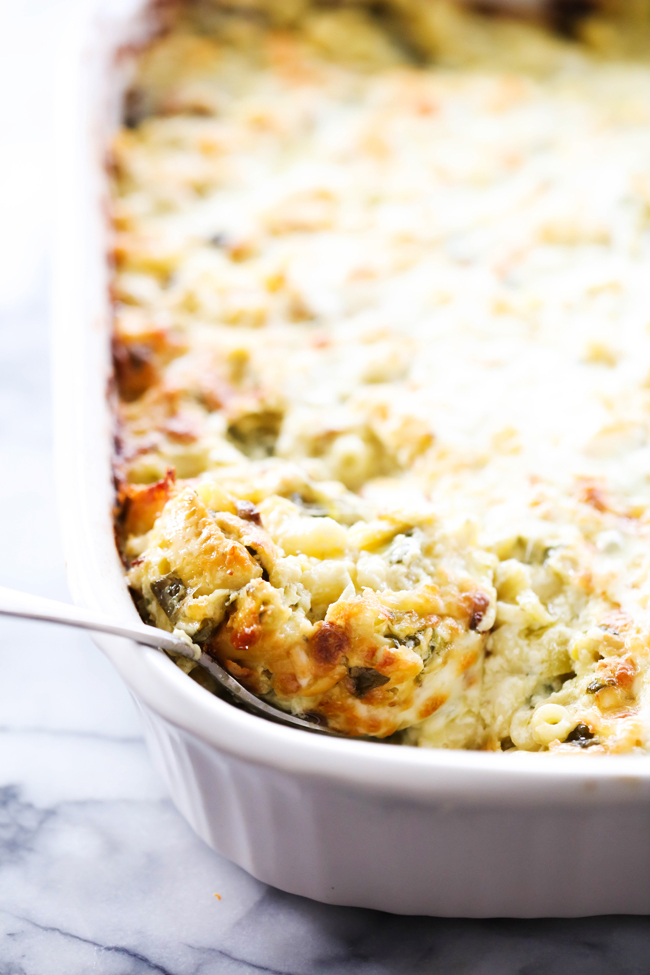 This Spinach Artichoke Mac and Cheese is full of flavor and is loaded with cheesy creamy goodness. This is a fun spin off from the classic spinach artichoke dip and will be a dinner that the whole family will love.