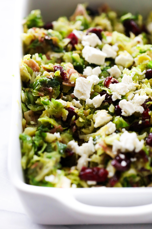 This Warm Brussels Sprouts Salad is mouthwatering delicious. The brussels sprouts are cooked to perfection and are the perfect chopped size. Wonderful flavors are pulled from the bacon, craisins, feta cheese and balsamic glaze for a delightful bite.