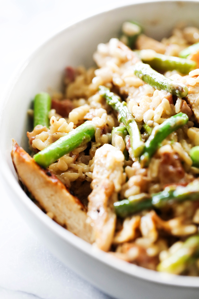 Asparagus Chicken Pancetta Risotto in a white bowl.