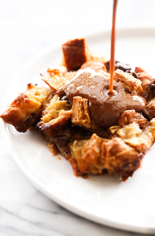 This Chocolate Croissant Bread Pudding will be one of THE BEST things you EVER eat. The flavor is truly spectacular and the texture is phenomenal. Chocolate is scattered throughout each and every bite of the delicious buttery and flaky croissants. The chocolate syrup is the perfect finishing touch. This will be a recipe you revisit over and over again!