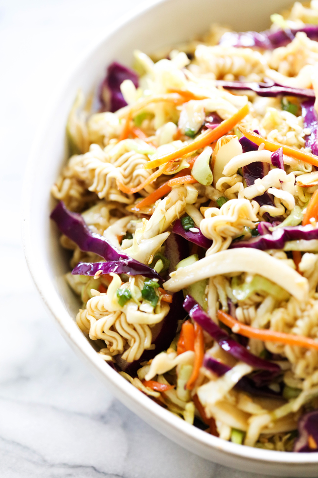 Overhead view of Ramen Noodle Salad in a white bowl.