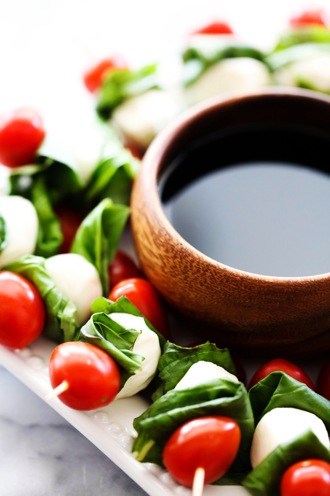 These Caprese Kabobs are the perfect party food. They are comprised of tomatoes, basil, mozzarella with a beautiful balsamic glaze drizzled over top. They are so simple to put together and are always a crowd favorite!