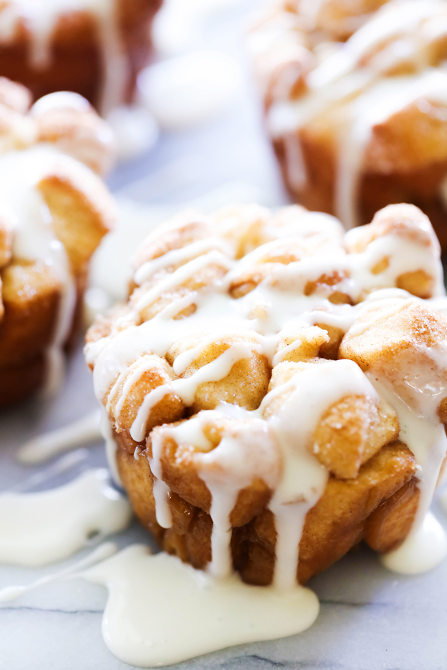 Monkey Bread Muffins drizzled with vanilla icing.