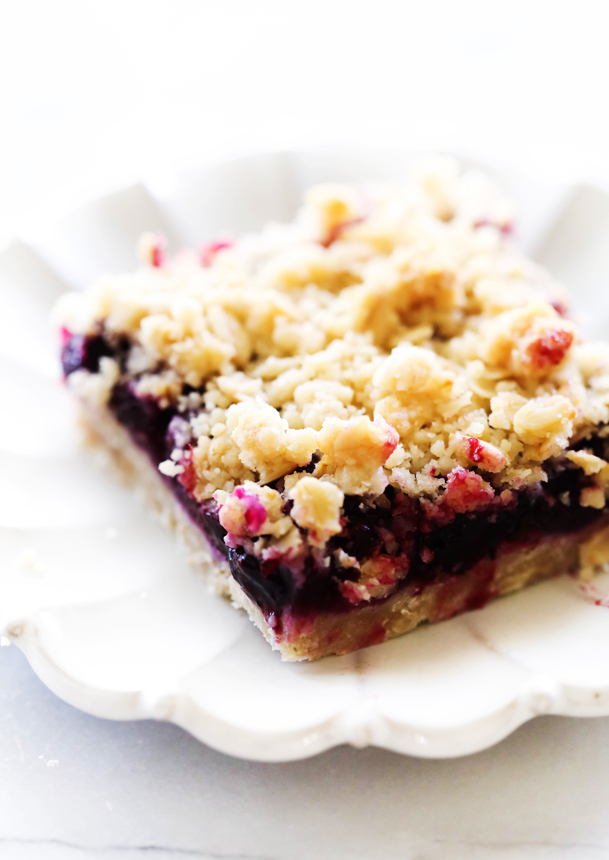 Lemon Blueberry Crumble Bars on a white plate.