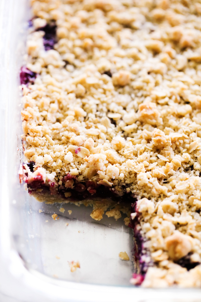 Pan of Lemon Blueberry Crumble Bars with a square cut out.
